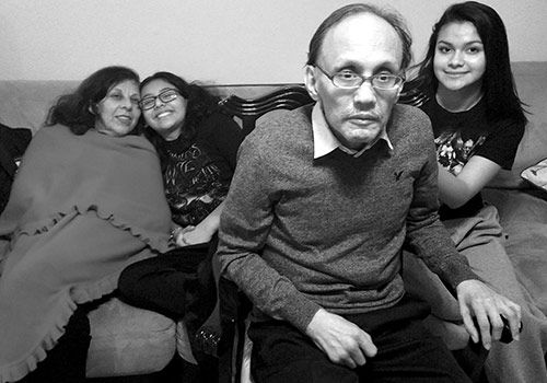 Ivanna sitting with her grandparents as a teenager.